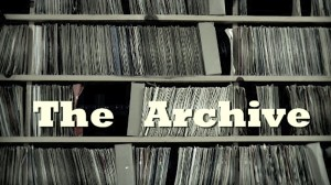 Picuture of Title, The Archive, against a shelf of records